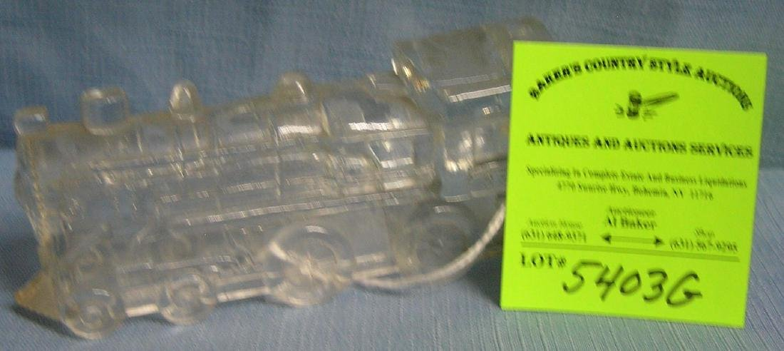Early glass locomotive candy container
