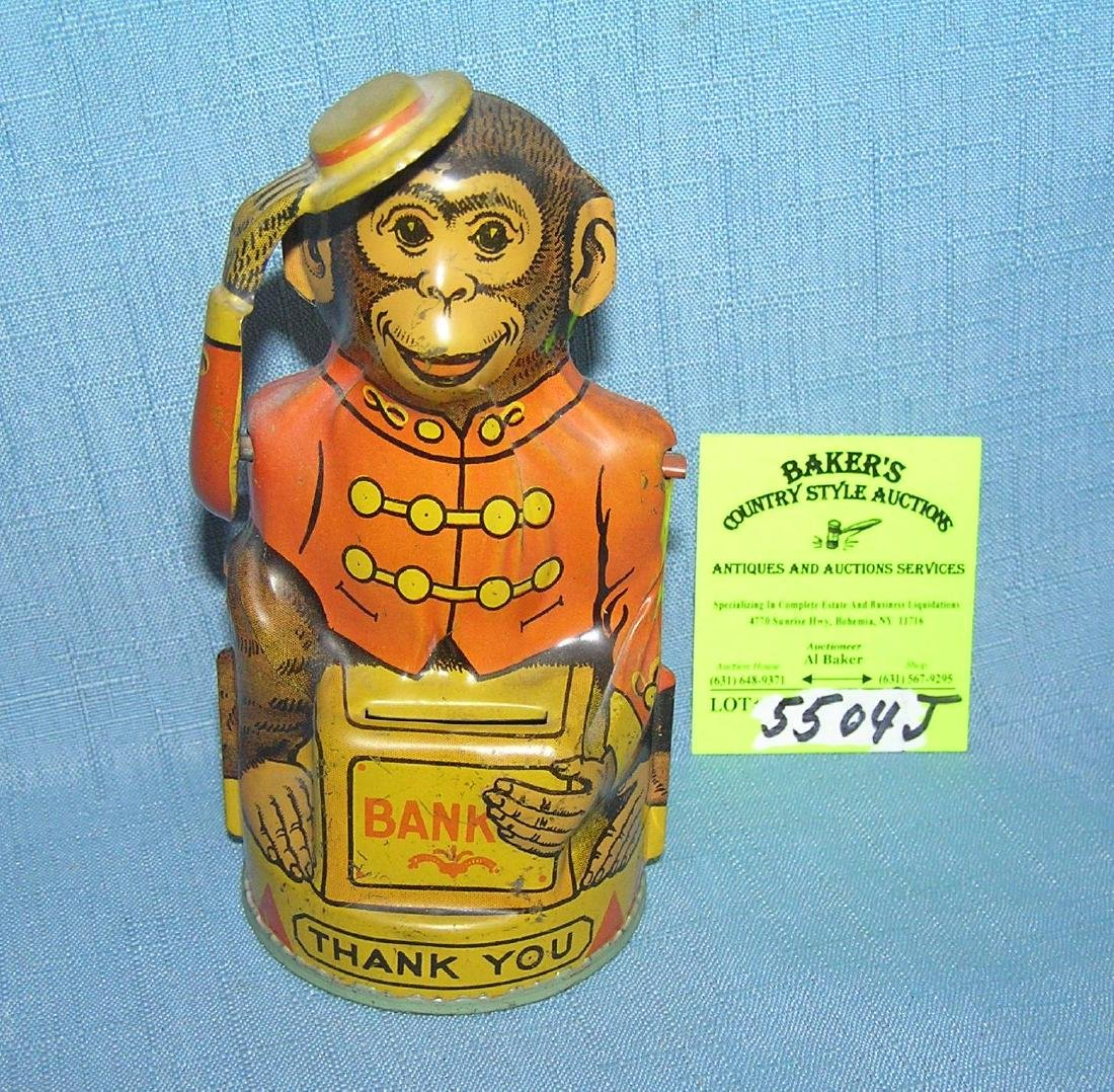 All tin mechanical monkey tipping hat coin bank