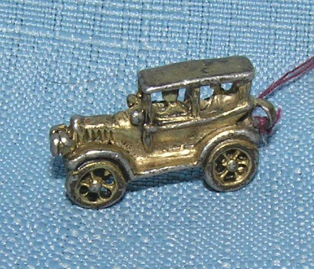 Early cast metal 2 passenger sedan miniature toy car