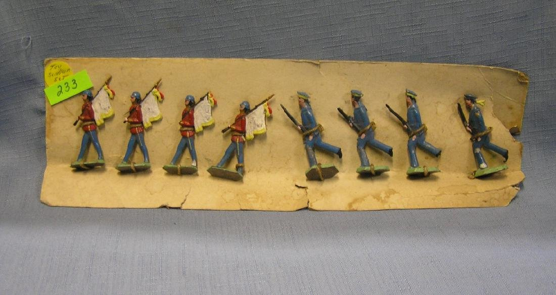 Eight piece antique hand painted toy soldier set