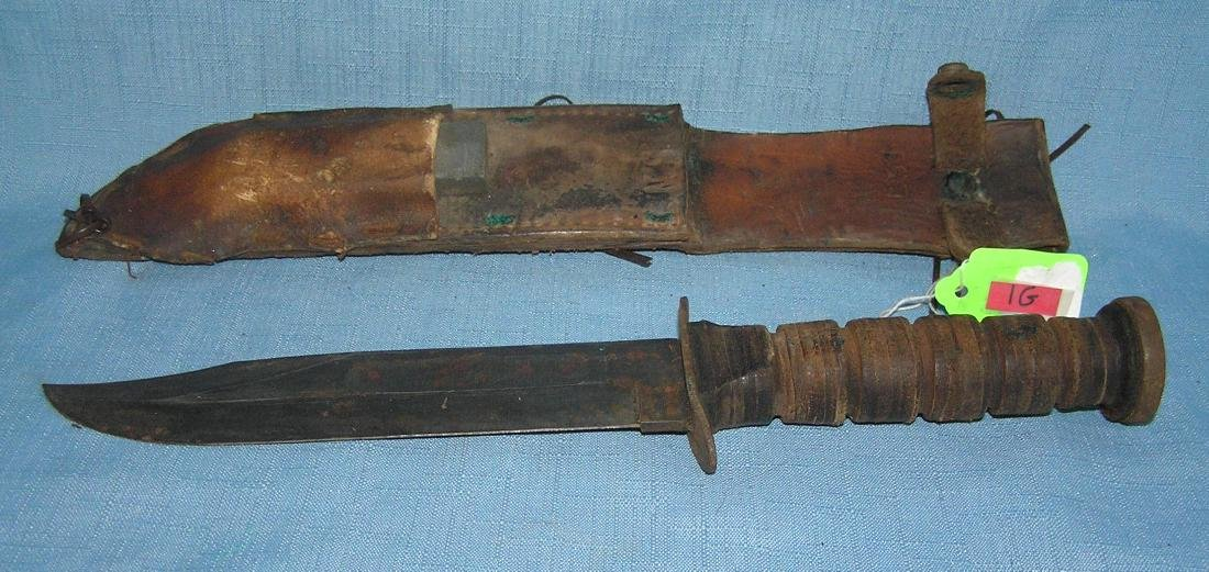 WWII US Navy fighting knife with scabbard and sharpener