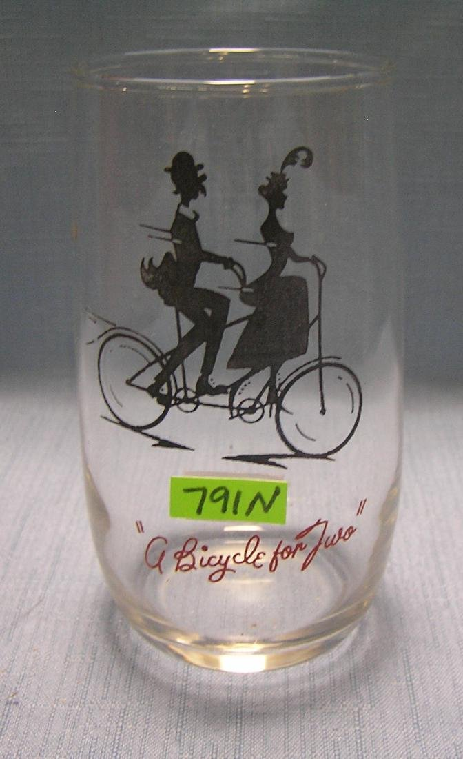 Early bicycle themed drinking glass
