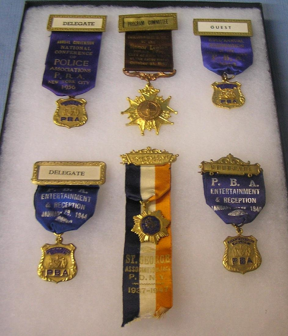 Large group of early police medals and ribbons
