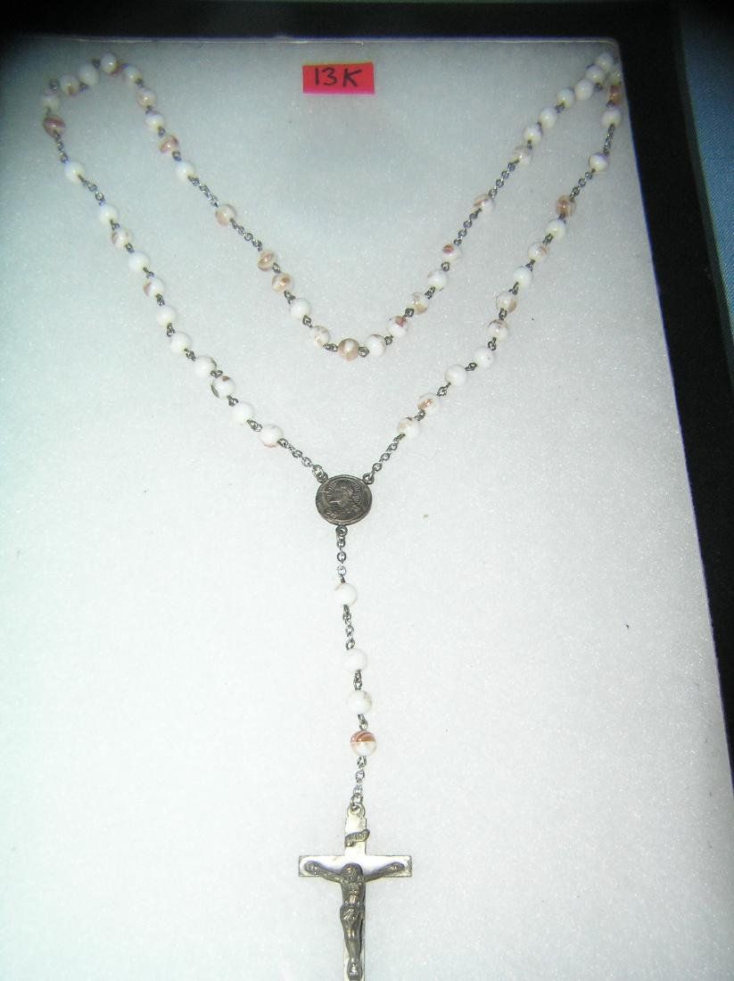 Religious beaded and silver plated religious necklace