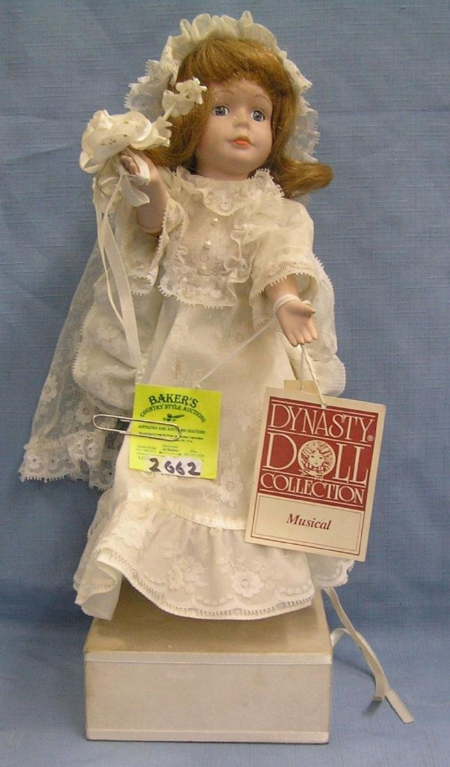 Vintage porcelain musical bride doll