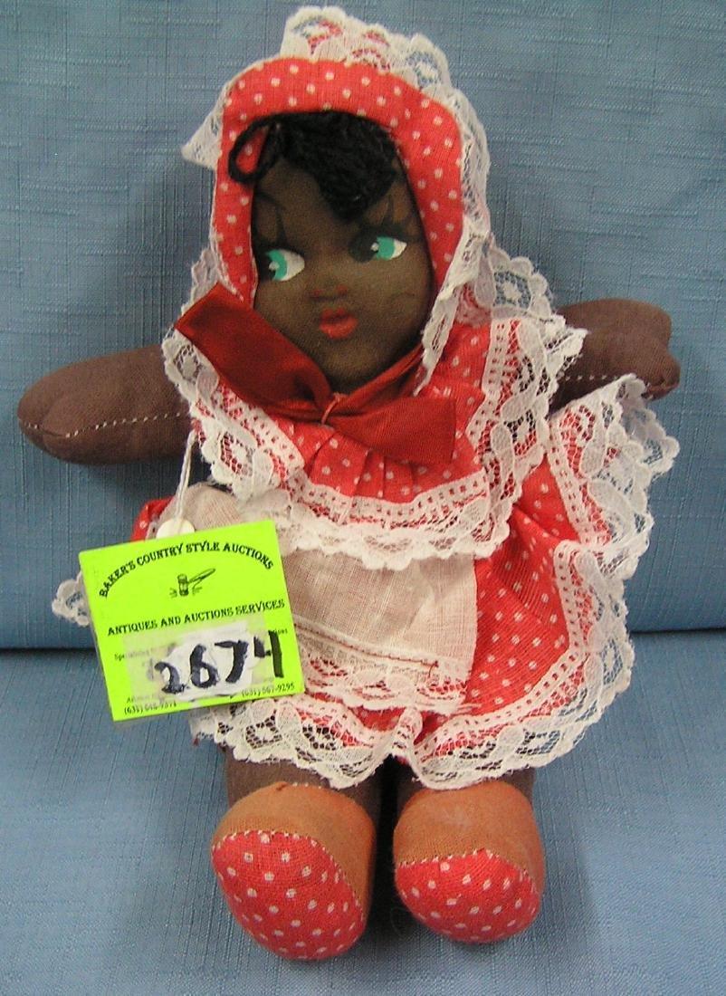 Early folk art black child doll