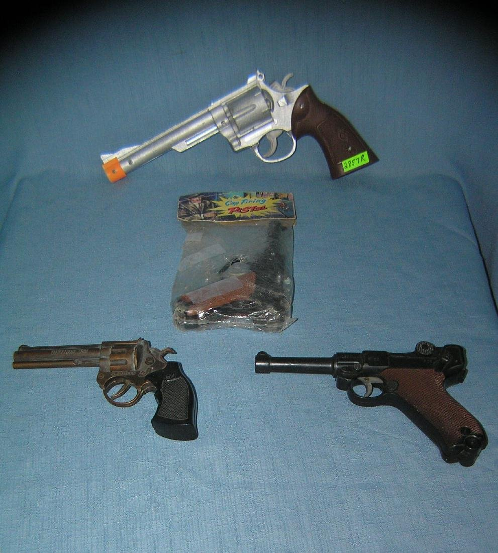 Group of 4 vintage toy plastic cap guns and more.
