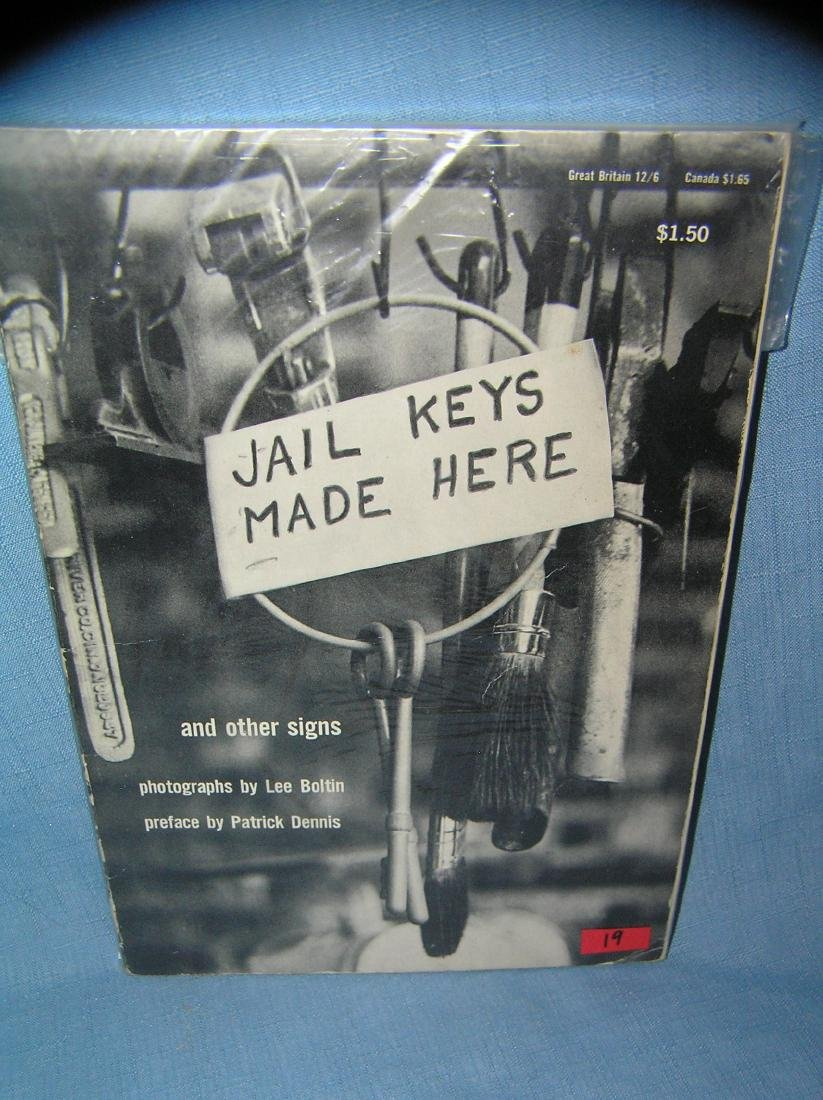 Jail Keys Made Here and other advertising signs