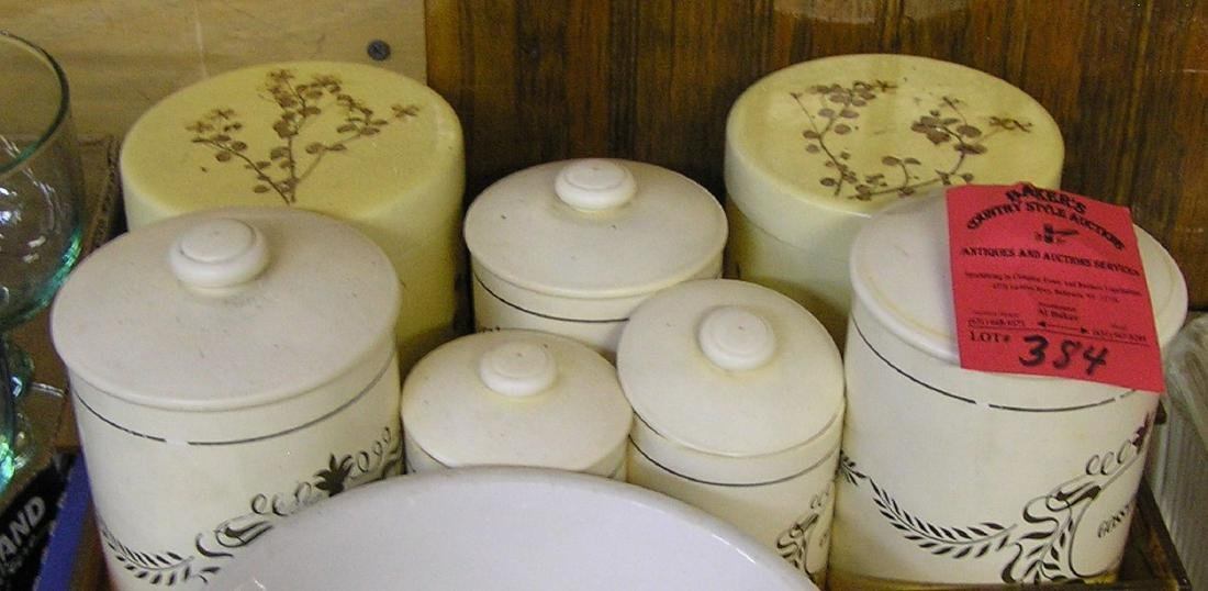 Group of vintage canisters and serving tray