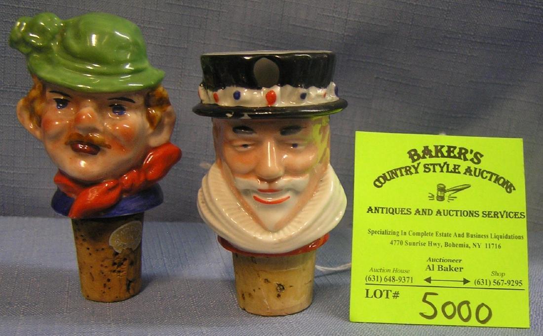 Pair of vintage porcelain liquor bottle stoppers