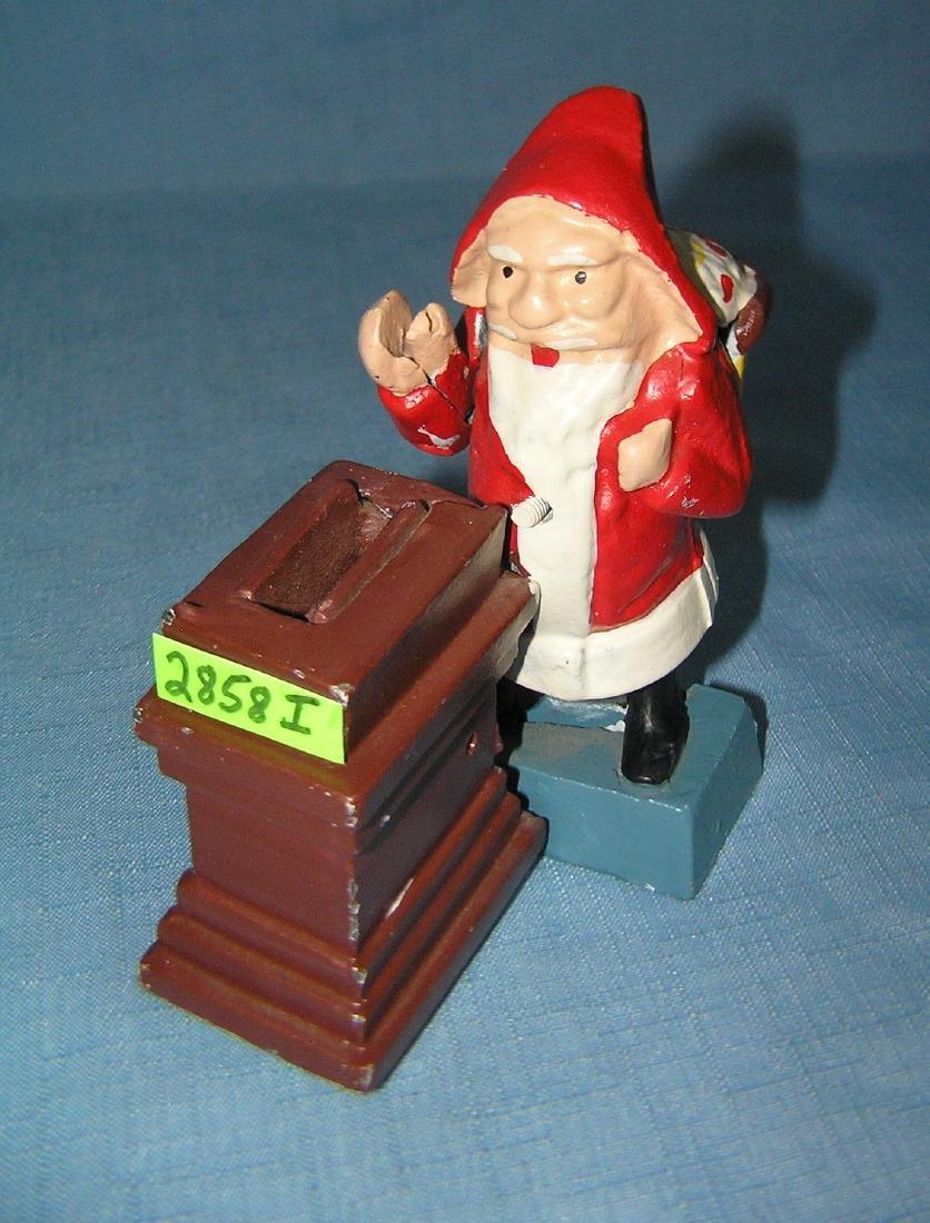 Cast iron Santa Claus mechanicalanical bank