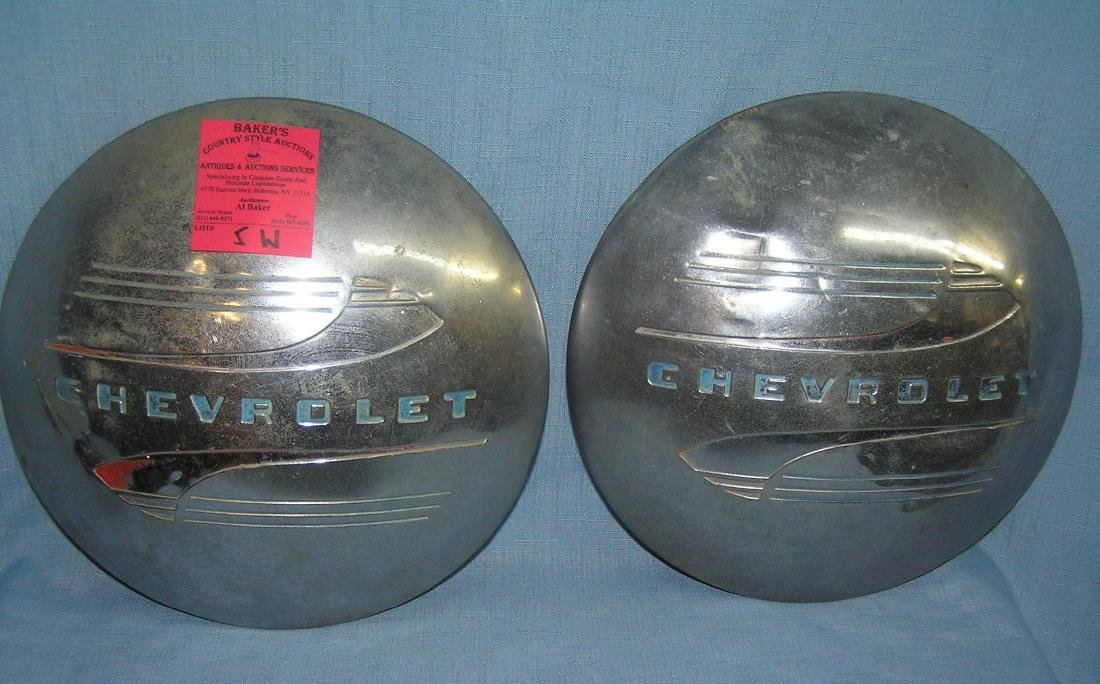 Pair of antique Chevrolet hub caps ca. 1930