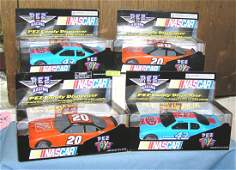 Collection of vintage NASCAR candy dispensers