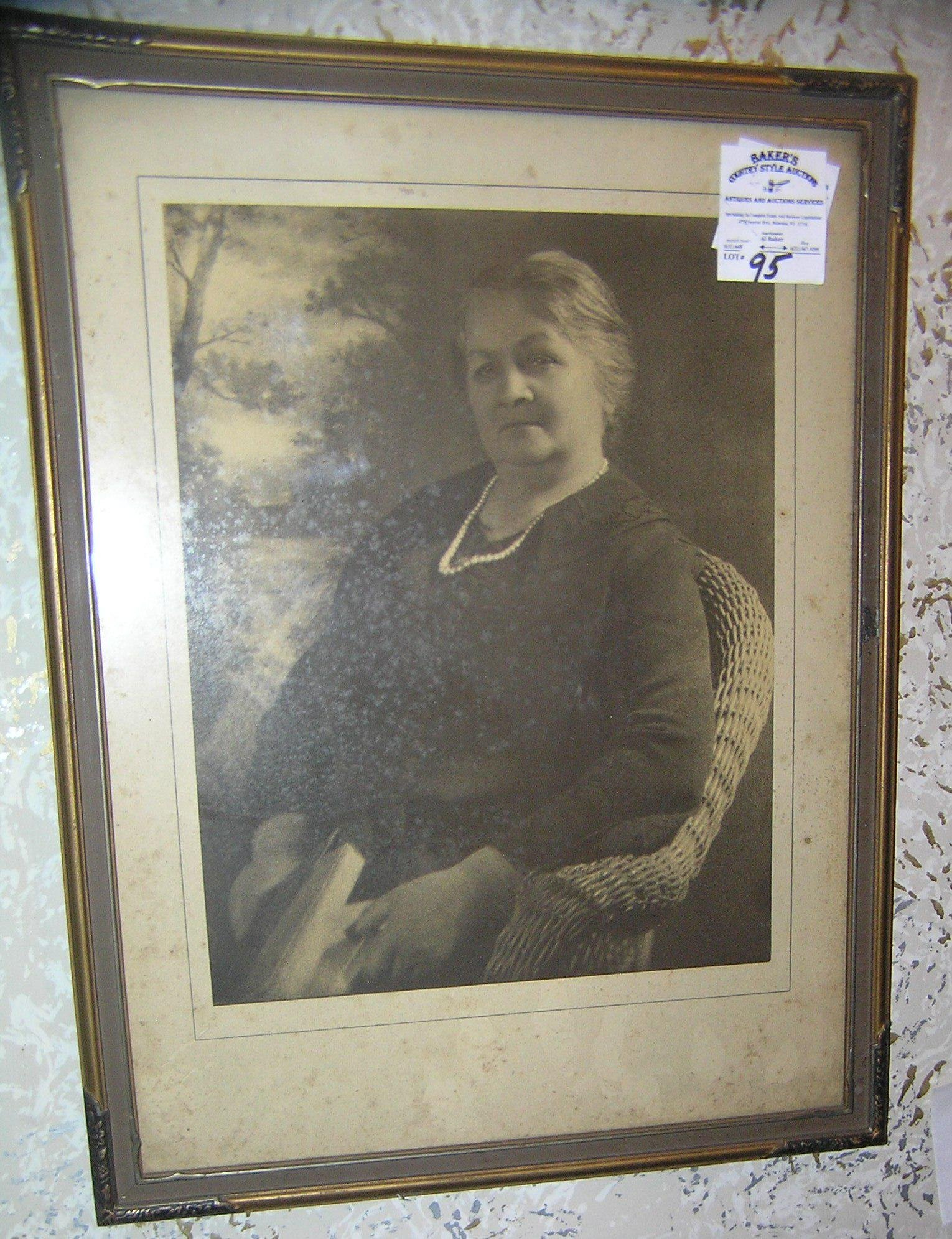 Antique photograph of a woman in a wicker chair
