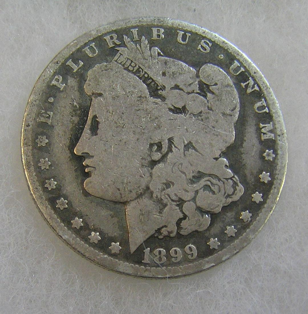 1899-O Morgan silver dollar in fair condition