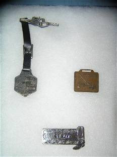 Group of vintage watch fobs and Western badge