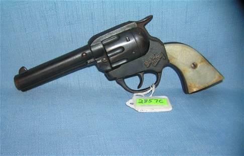 Early Gene Autry all cast iron cap gun
