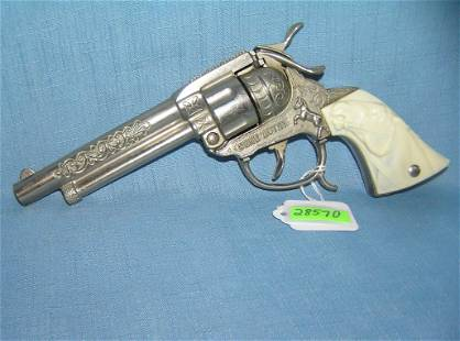 Vintage Gene Autry cast metal cap gun
