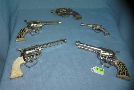 Group of 5 all cast metal cap guns