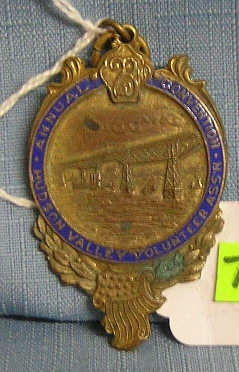 Antique brass and blue enameled badge