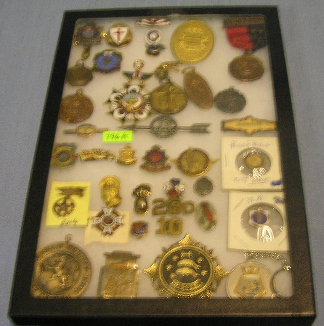 Early medals, badges, pins, awards and more