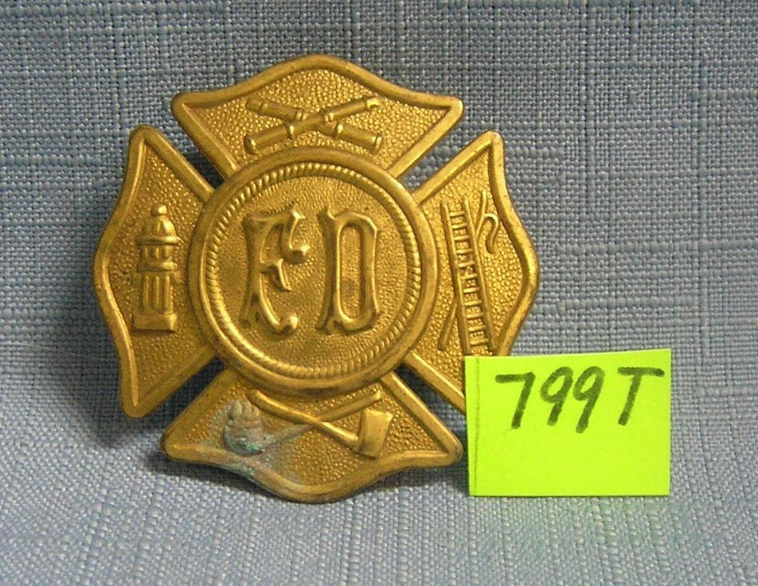 Antique F.D. hat badge