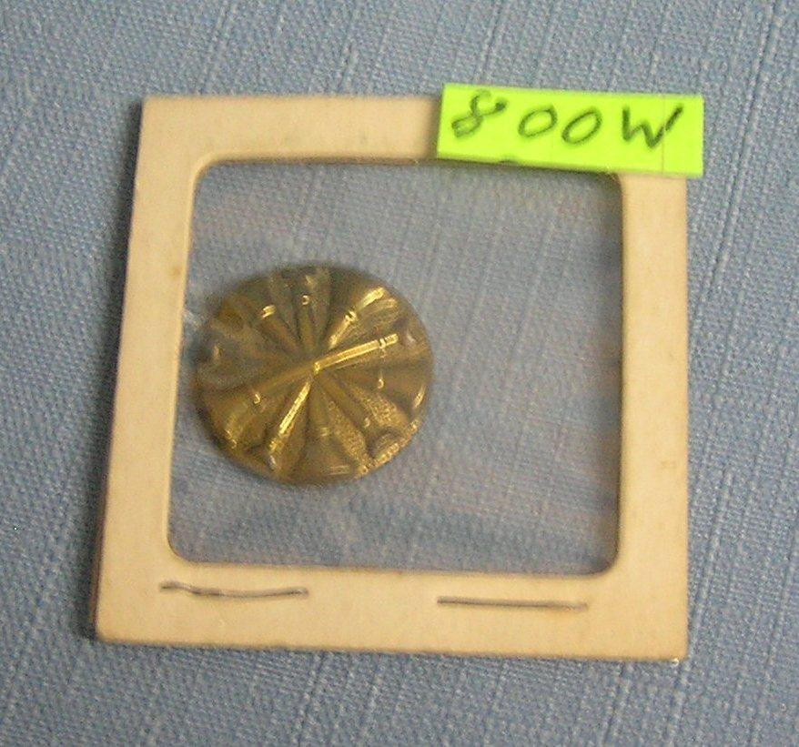 Early Brass fire trumpet shield