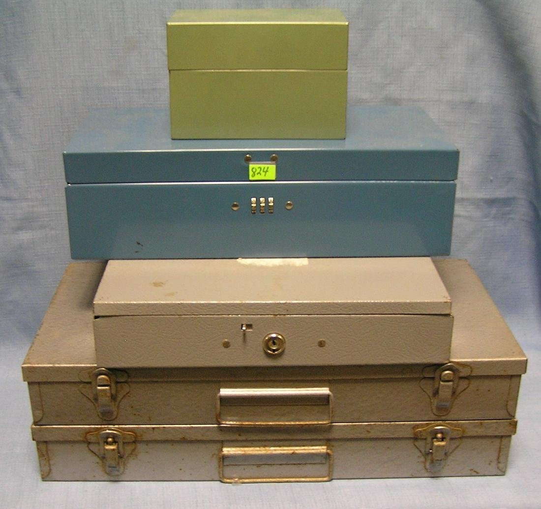 Group of four metal storage boxes