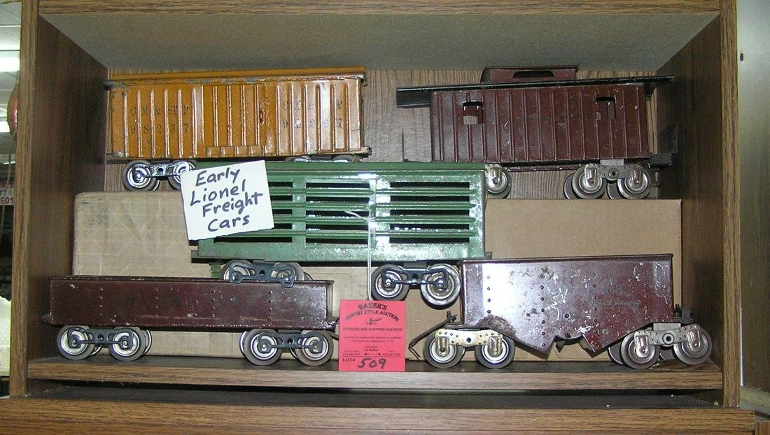 Group of five early Lionel freight cars