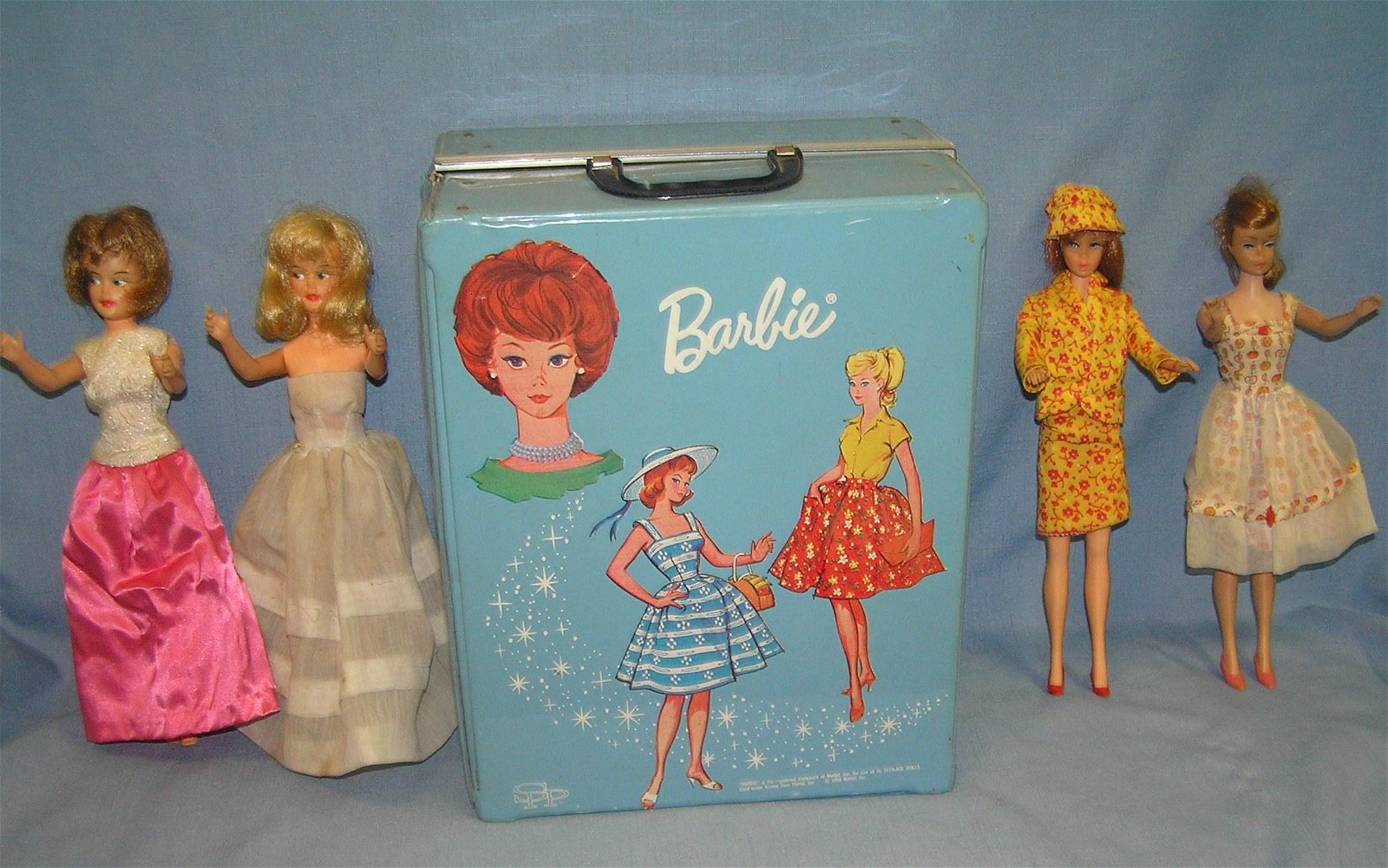 Barbie doll collection featuring 4 vintage dolls and