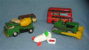 Group of vintage tin and plastic toys