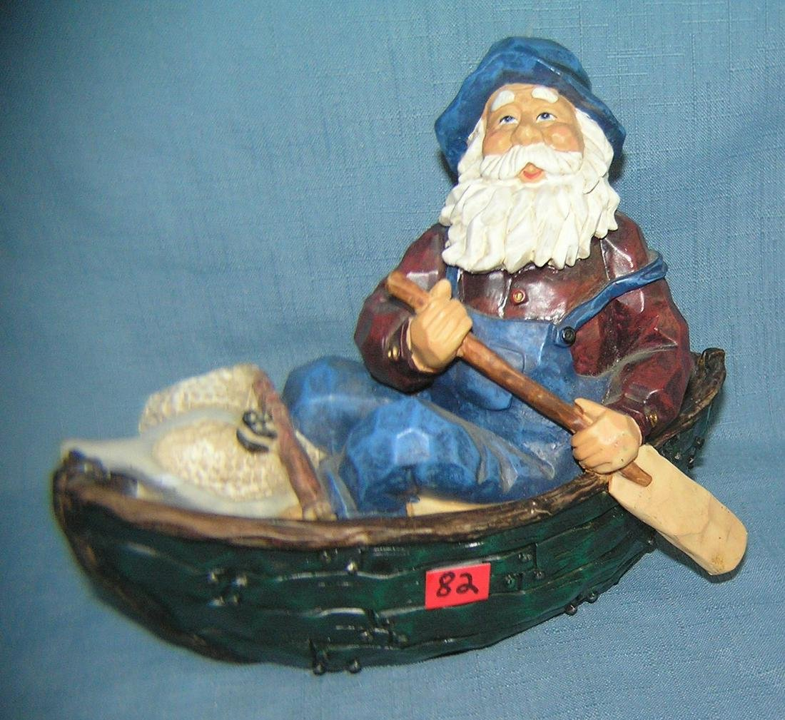Hand painted fisherman in rowboat figurine