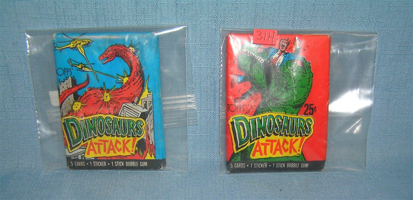 Pair of dinosaurs attacks unopened wax card packs