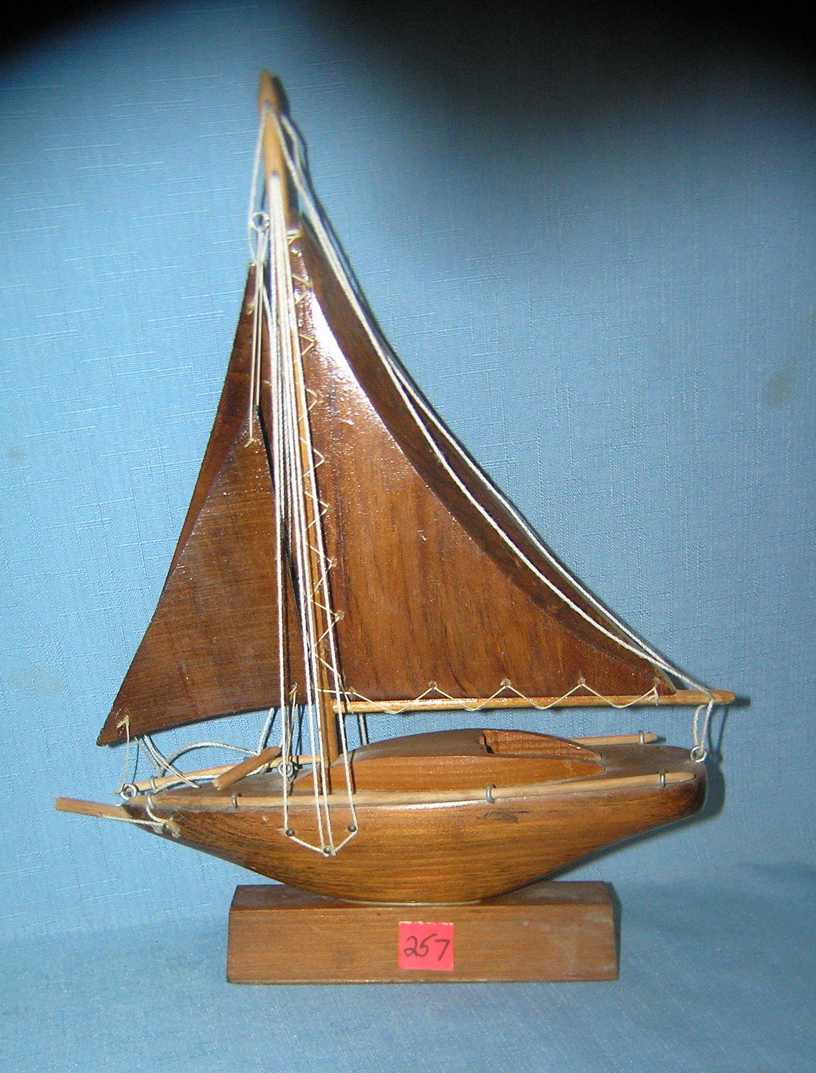 Hand carved wood sail boat on stand