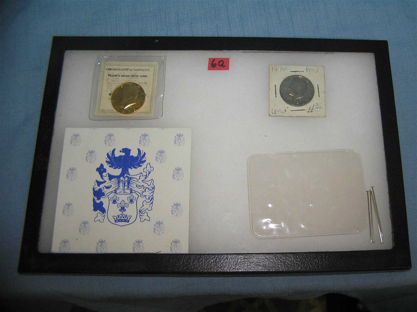 Pair of high grade John F Kennedy half dollar coins