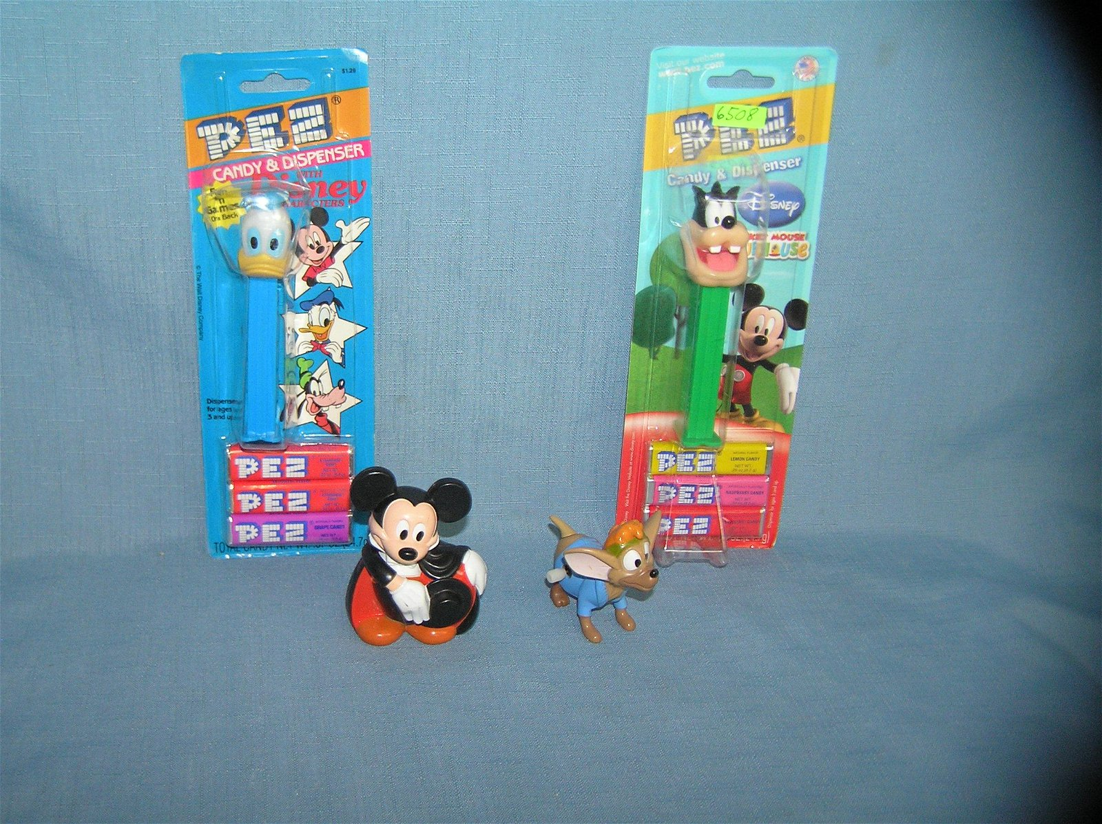 Group of vintage Disney PEZ candy containers and toys