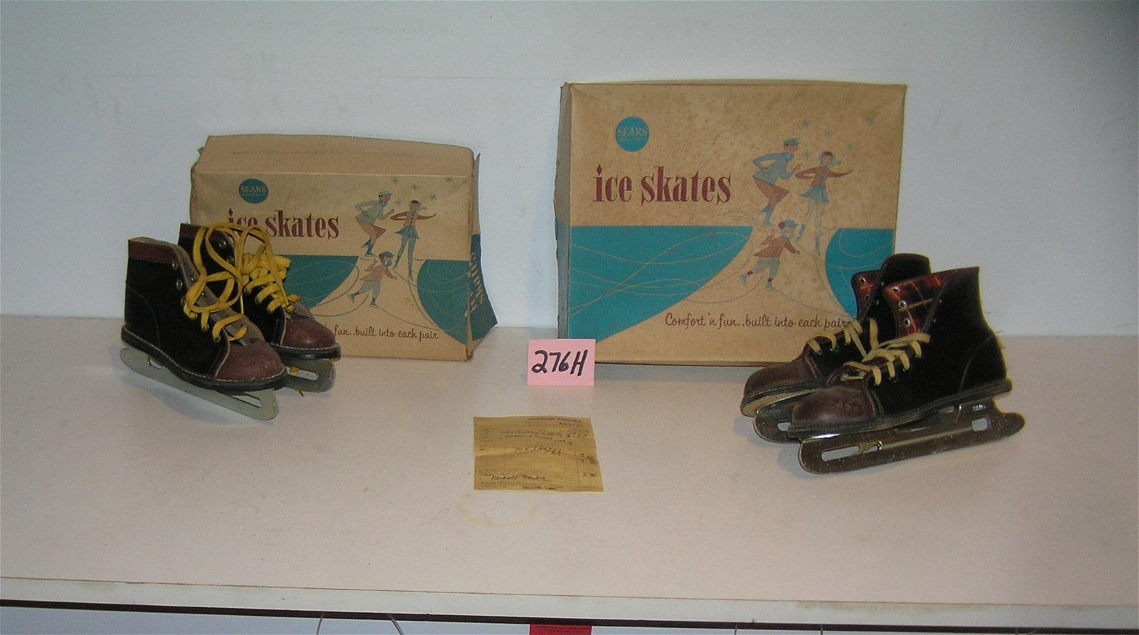 2 pairs of early leather and metal ice skates