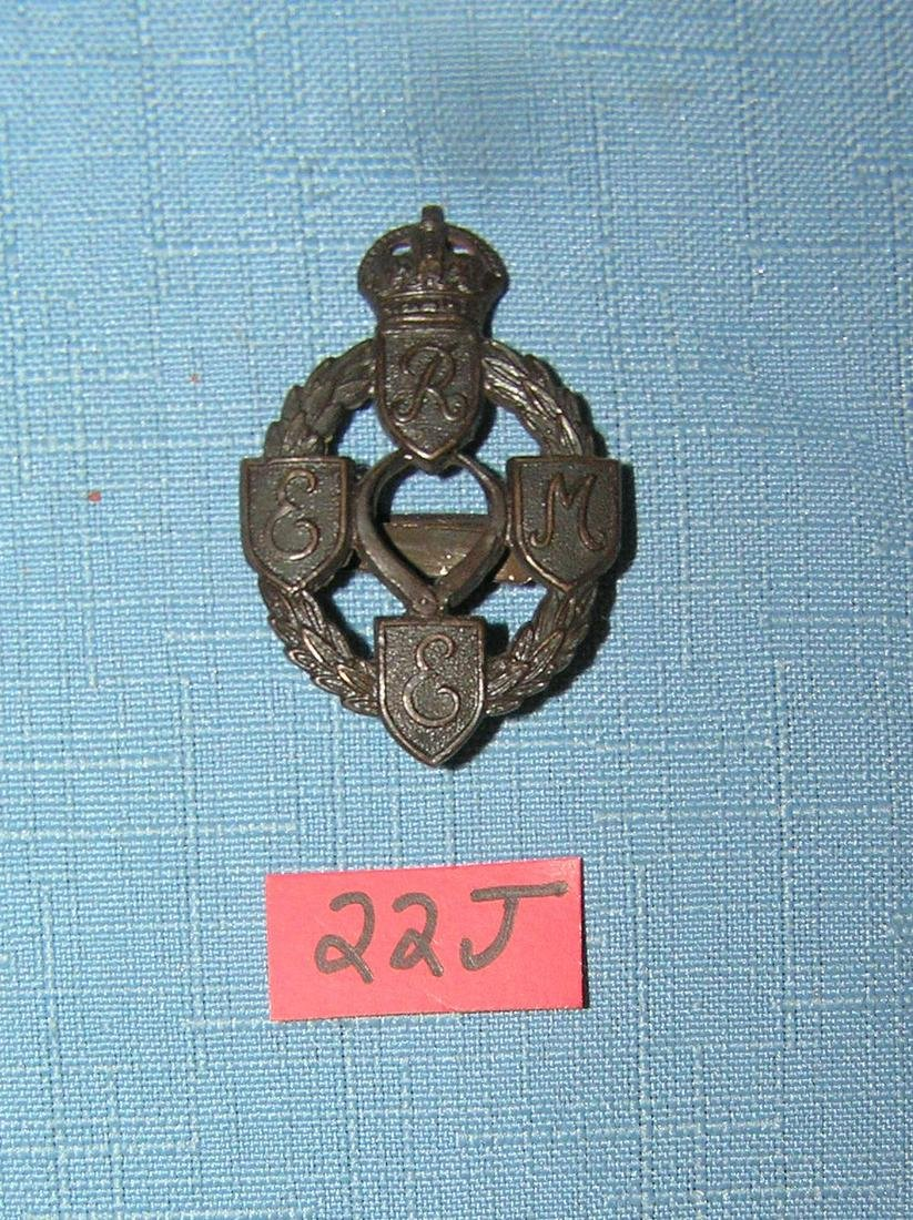 Antique brass British Army Corps badge