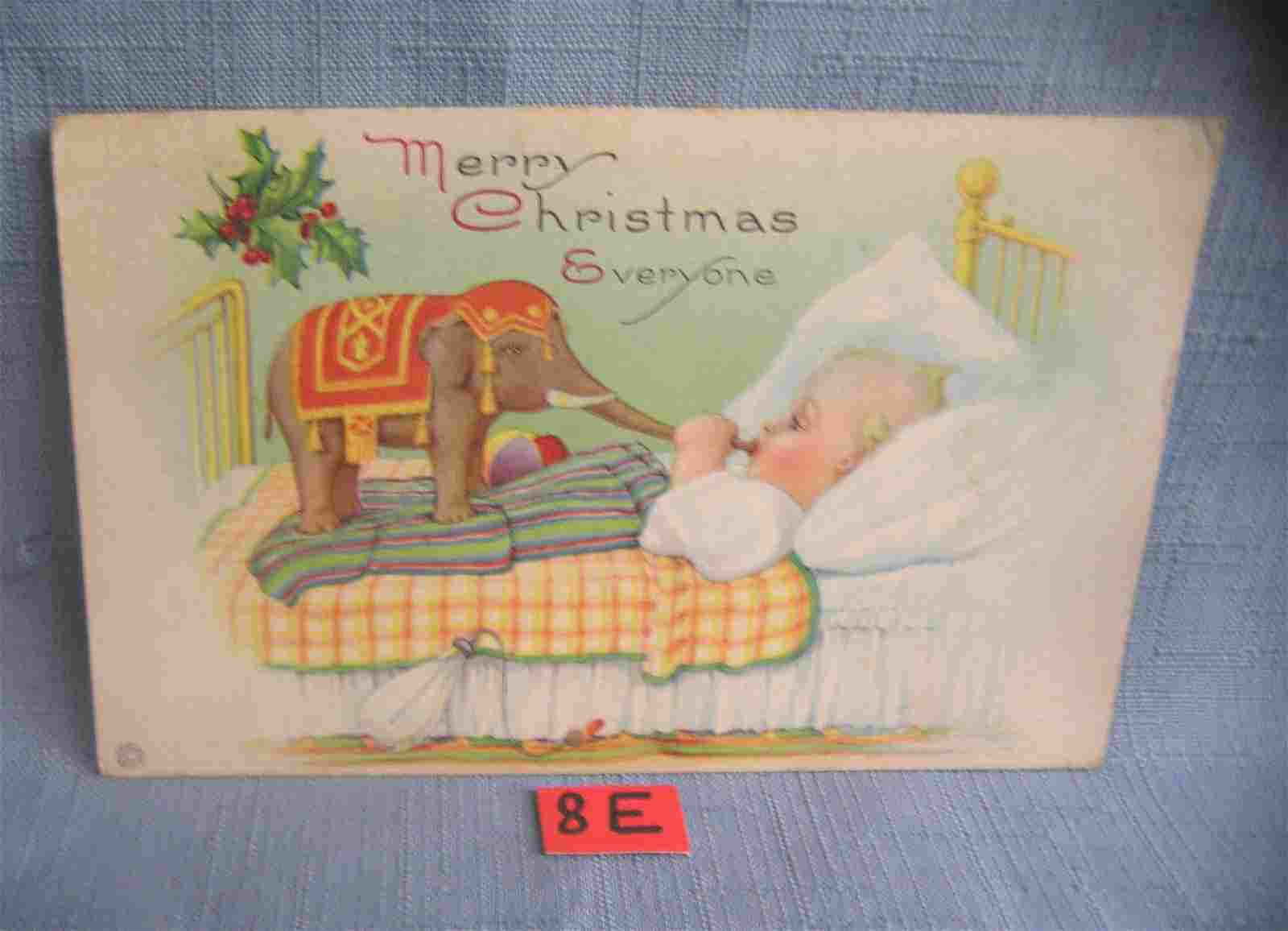 Christmas post card features a child with a Dumbo toy