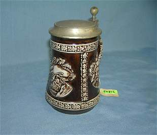 Vintage beer stein with 3 historical figures