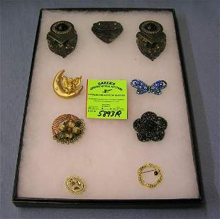Group of quality costume jewelry pins and earrings