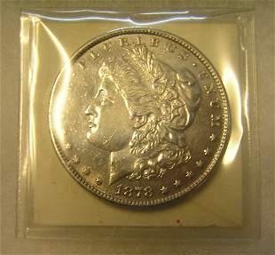 1878S Morgan silver dollar in AU condition