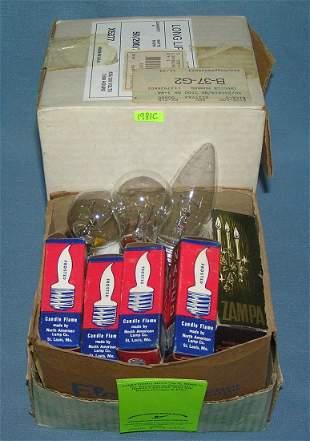 Box full of vintage mupiltible size light bulbs