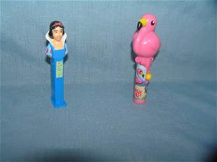 Pair of candy containers includes Disney PEZ and Pink