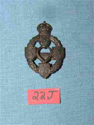 Antique brass British Army Corps badge