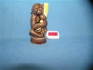 Porcelain glazed monkey and banana figurine