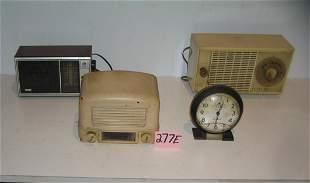 Group of old radios and a Big Ben alarm clock