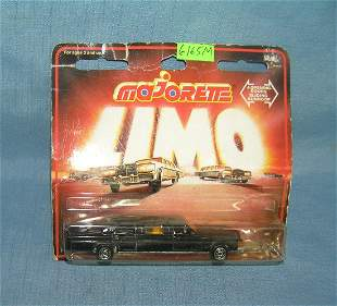 Vintage cast metal stretch limo toy mint on card
