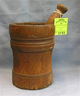 Antique wooden mortar and pestle