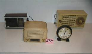 Group of old radios and a Big Ben alarm clock